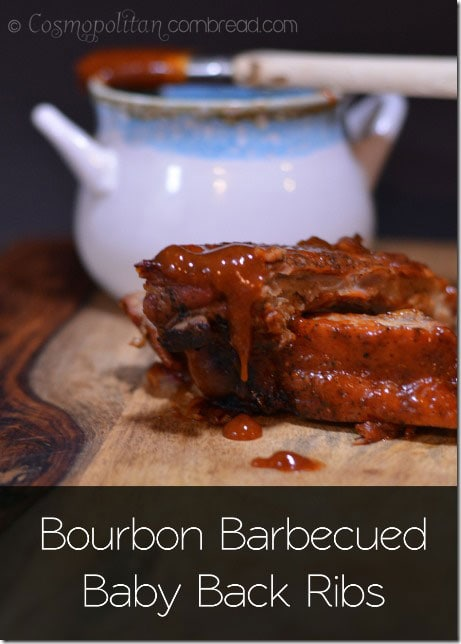 Bourbon Barbecued Baby Back Ribs - Tender, apple braised baby back ribs glazed with rich barbecue sauce laced with bourbon. You definitely want to make these ribs from Cosmopolitan Cornbread!