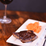 Steak Chevillot and Salade de carottes râpées | Beautiful, seared sirloin steak bathed in a red wine and shallot pan sauce and served with a fresh carrot salad. Get the recipe from Cosmopolitan Cornbread