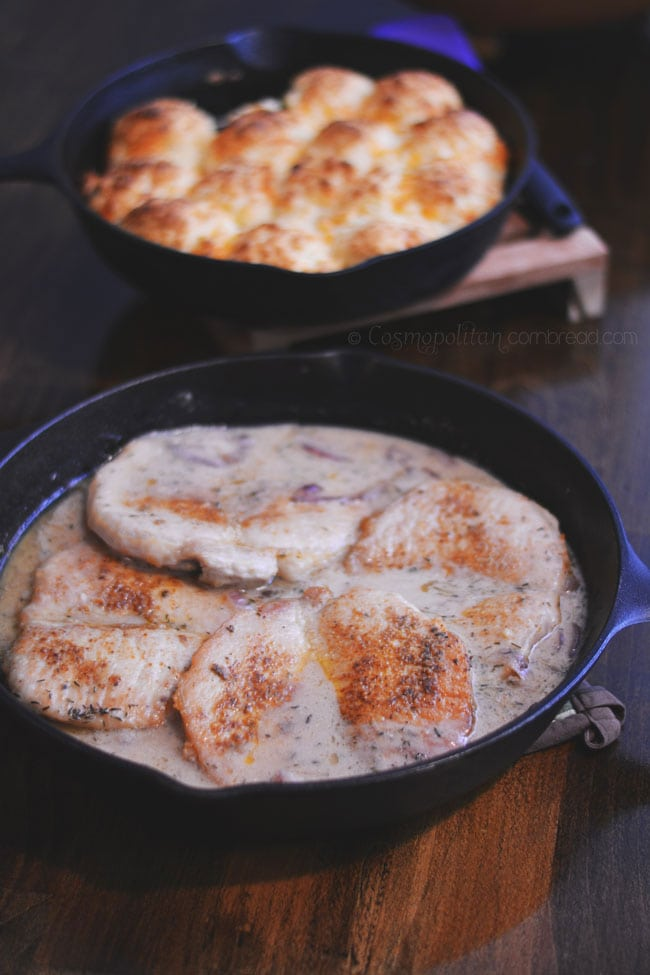 Delicious Pork Chops smothered in a creamy onion gravy - get the recipe from Cosmopolitan Cornbread