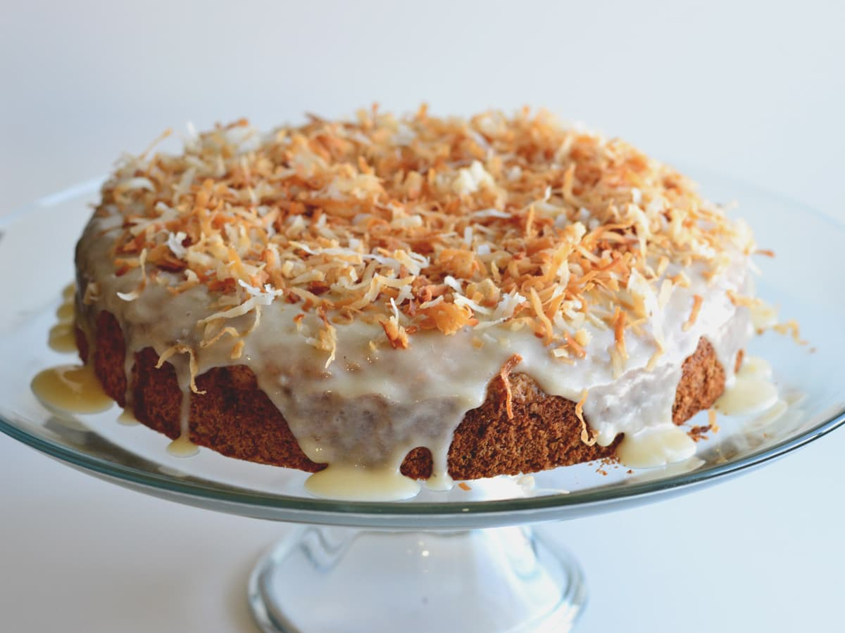 Coconut Rum Cake is a rich yellow cake, bathed in a rum & coconut cream, and topped with rum-coconut glaze and toasted coconut. Get this insanely good recipe from Cosmopolitan Cornbread