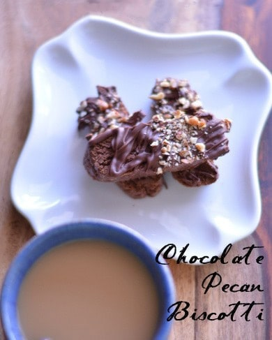 Rich, chocolate biscotti drizzled with melted chocolate and sprinkled with chopped, toasted pecans. These Chocolate Pecan Biscotti cookies will make coffee time very, very happy.