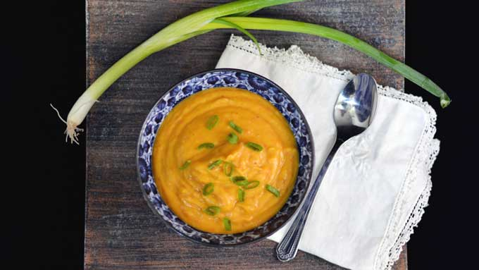 Enjoy the flavors of autumn with this Butternut Squash Soup from your slow cooker. Get the recipe from Cosmopolitan Cornbread