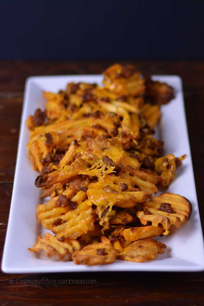 Nacho Waffle Fries with scrumptious Chorizo and melted cheese, they're sure to be the winner at your football parties. | Cosmopolitan Cornbread