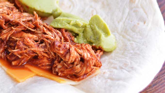 "Slow Cooker Chicken Tacos - a great ""toss and forget"" meal for a busy day. Get the recipe from Cosmopolitan Cornbread"