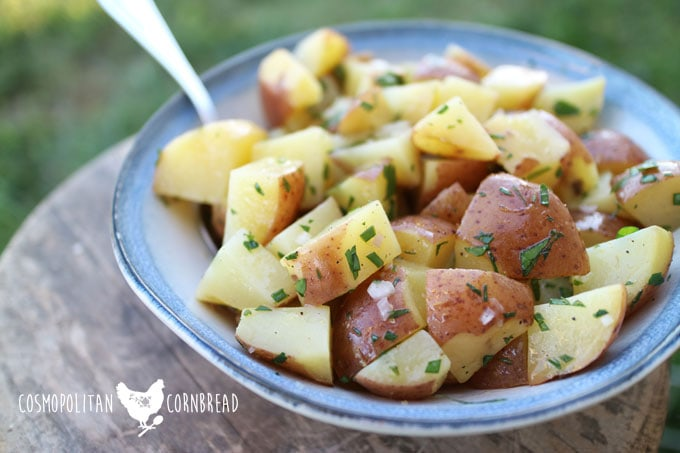 Herbed Lemon Potato Salad - a fresh and flavorful twist on a summer classic. Get the recipe from Cosmopolitan Cornbread