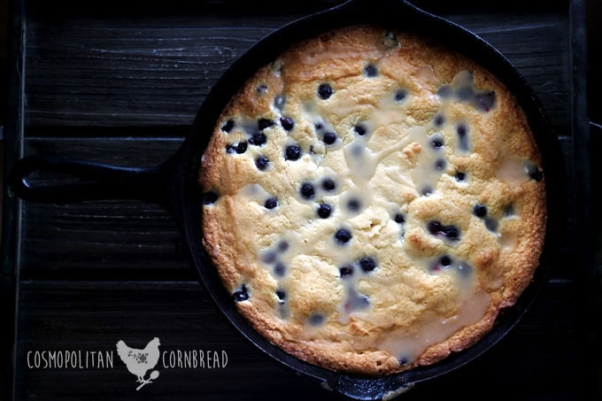 Lemon & Blueberry Skillet Cake from Cosmopolitan Cornbread. Enjoy these beautiful, fresh flavors together in a simple cake with lemon glaze.