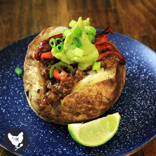 Paleo Taco Stuffed Baked Potatoes | Baked potatoes stuffed with delicious taco meat and sauteed peppers. You'll love this fun and easy supper recipe.