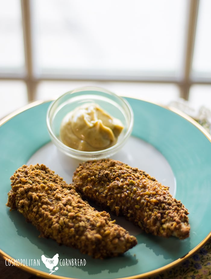 Pistachio Crusted Chicken Tenders - this paleo and low-carb recipe is great for any night of the week. The tenders are on the table in no time, and have a great crunchy coating everyone will love. Get the recipe from Cosmopolitan Cornbread