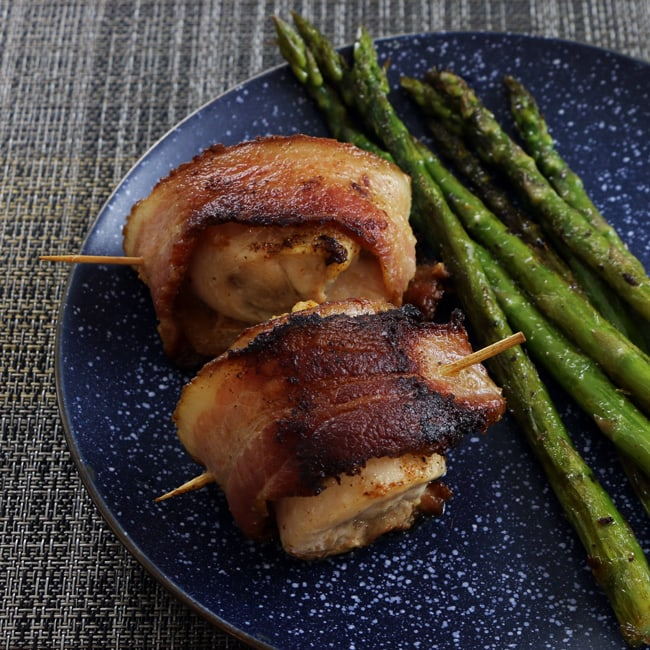 Juicy, seasoned chicken, wrapped in bacon and cooked to perfection. This paleo bacon-wrapped chicken is not only simple to make, but impressive enough for company. Get the recipe from Cosmopolitan Cornbread