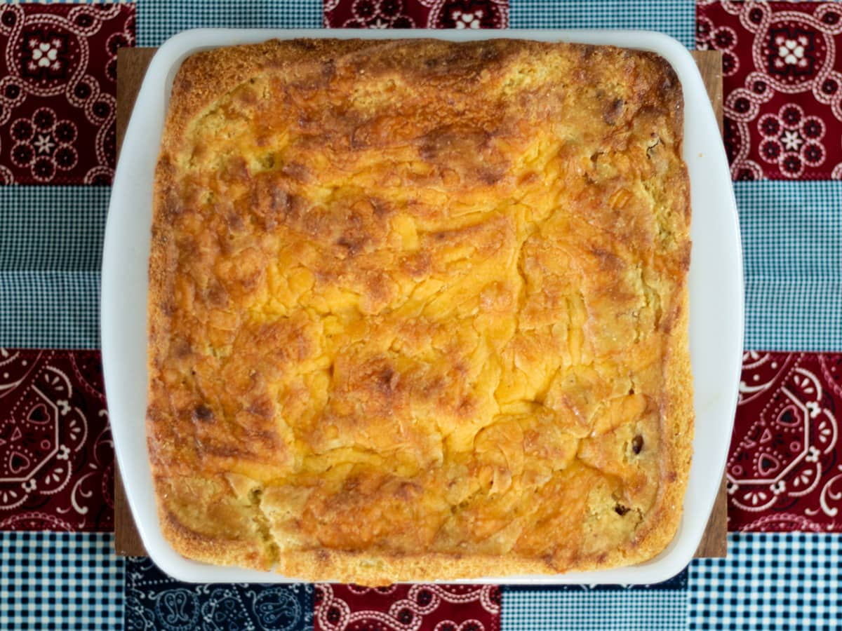 Sausage Cornbread Bake - With sausage, onion and cheese, this moist cornbread recipe is substantial enough to serve as a meal on its own.