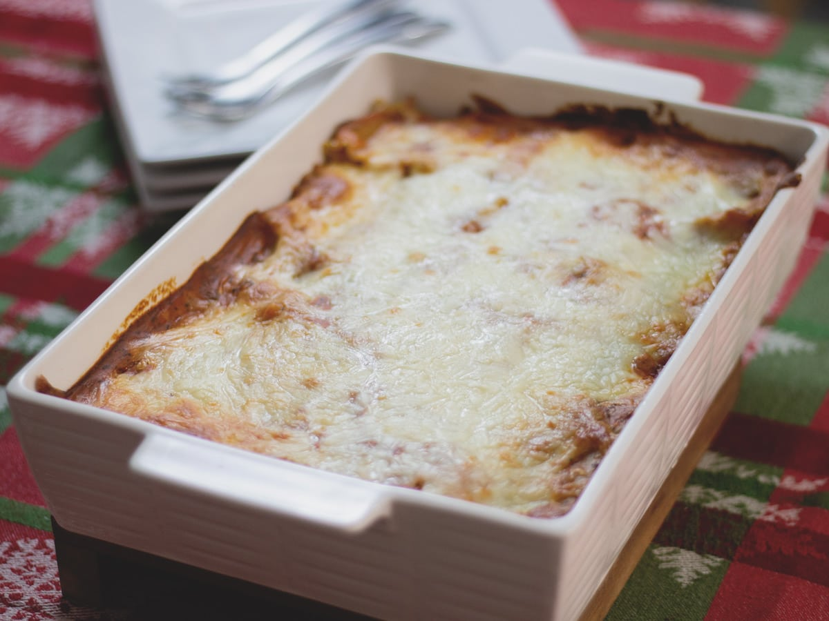 A delicious homemade lasagna with creamy béchamel and ricotta cheese inside. Traditional Lasagna is a comfort food classic.