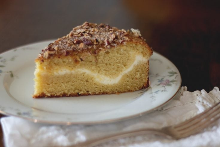 Sour Cream Coffee Cake with Cream Cheese Filling - Moist and decadent sour cream coffee cake with a tangy ribbon of cheese cream filling.