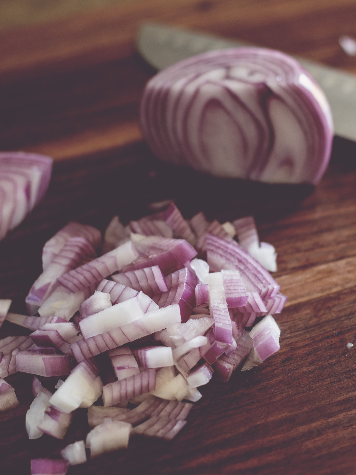 diced red onions on cutting board
