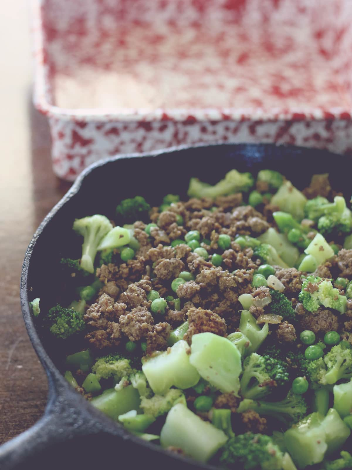 vegetables and ground beef in skillet