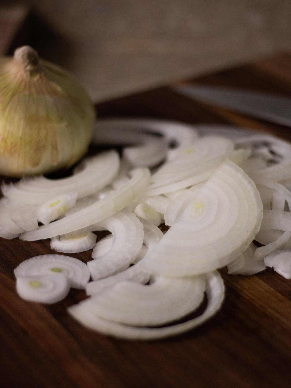 sliced onion on cutting board