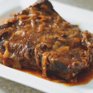 Beef Brisket with Caramelized Onions | Slow Cooker - Tender beef brisket in a rich, caramelized onion sauce.