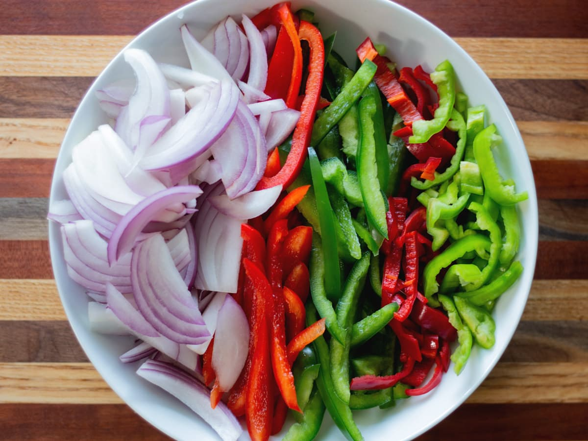 cut peppers and onion in a dish