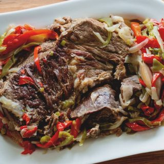 Peppered Beef is tender roast beef, smothered in peppers and onion and cooked in your Instant Pot.