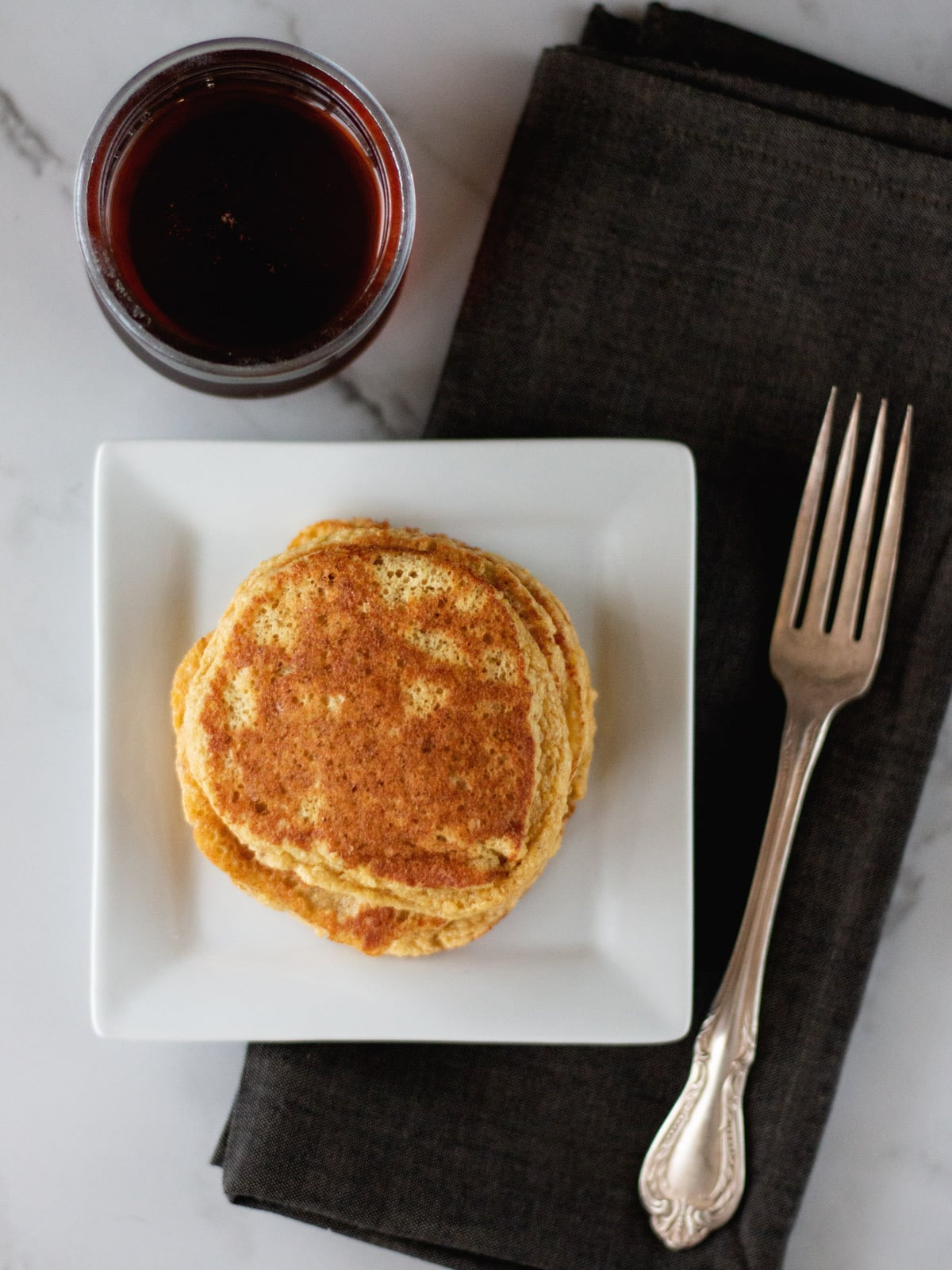 These paleo Banana Bread Pancakes with cinnamon and vanilla are absolutely irresistible!
