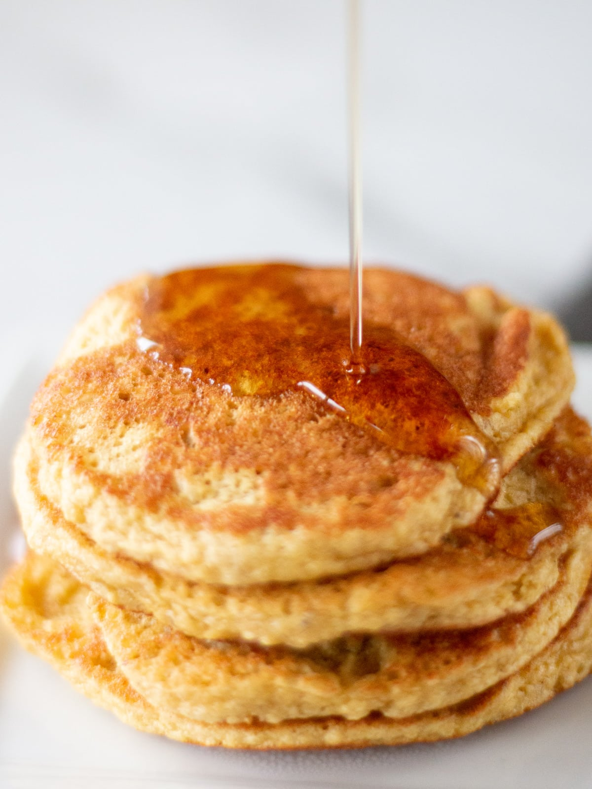 syrup pouring on pancakes
