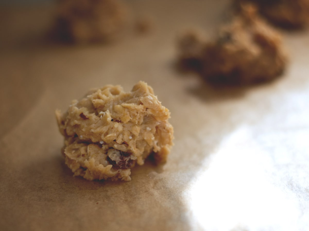 cookie dough scooped onto parchment paper