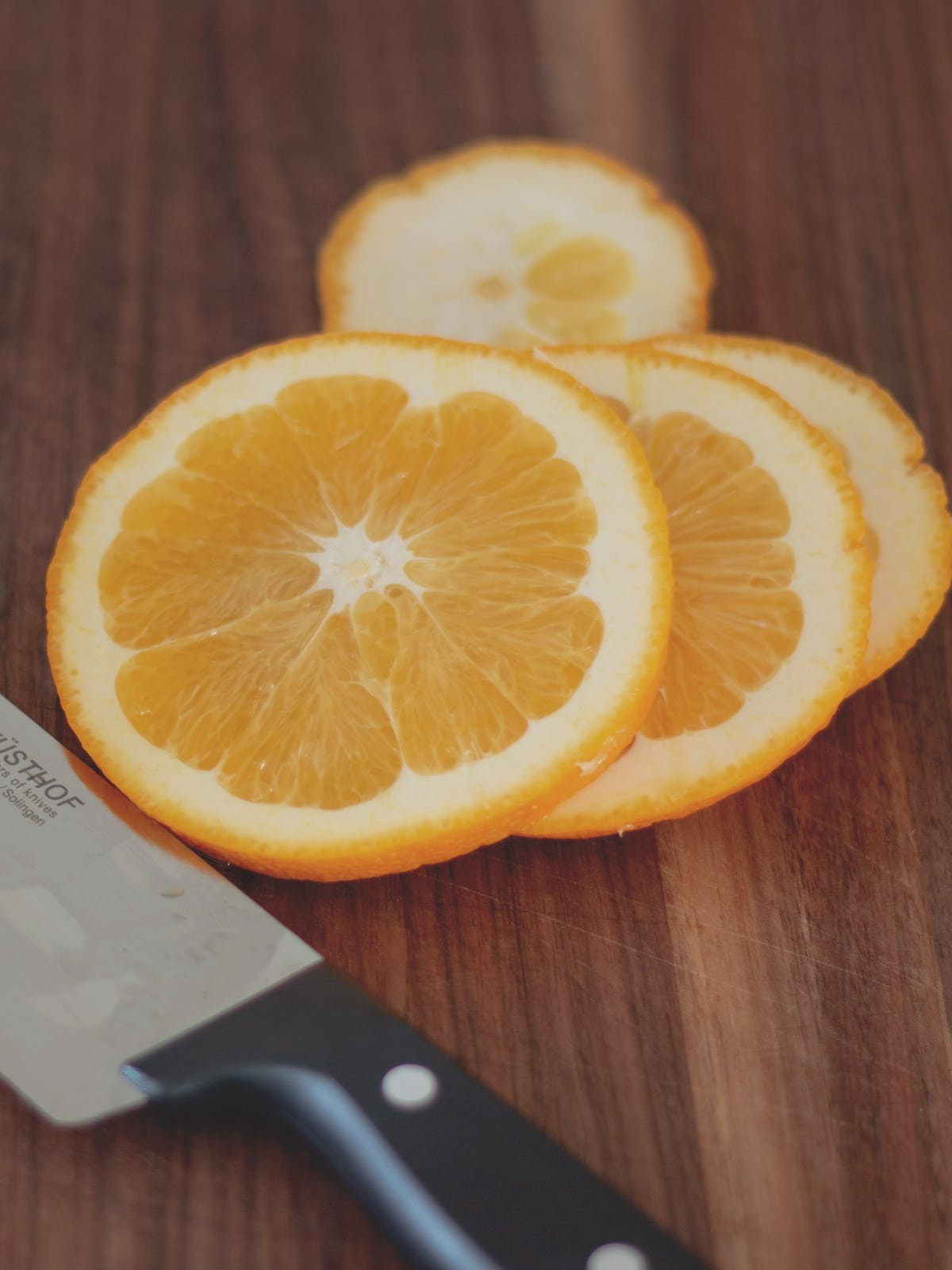orange slices on a cutting board