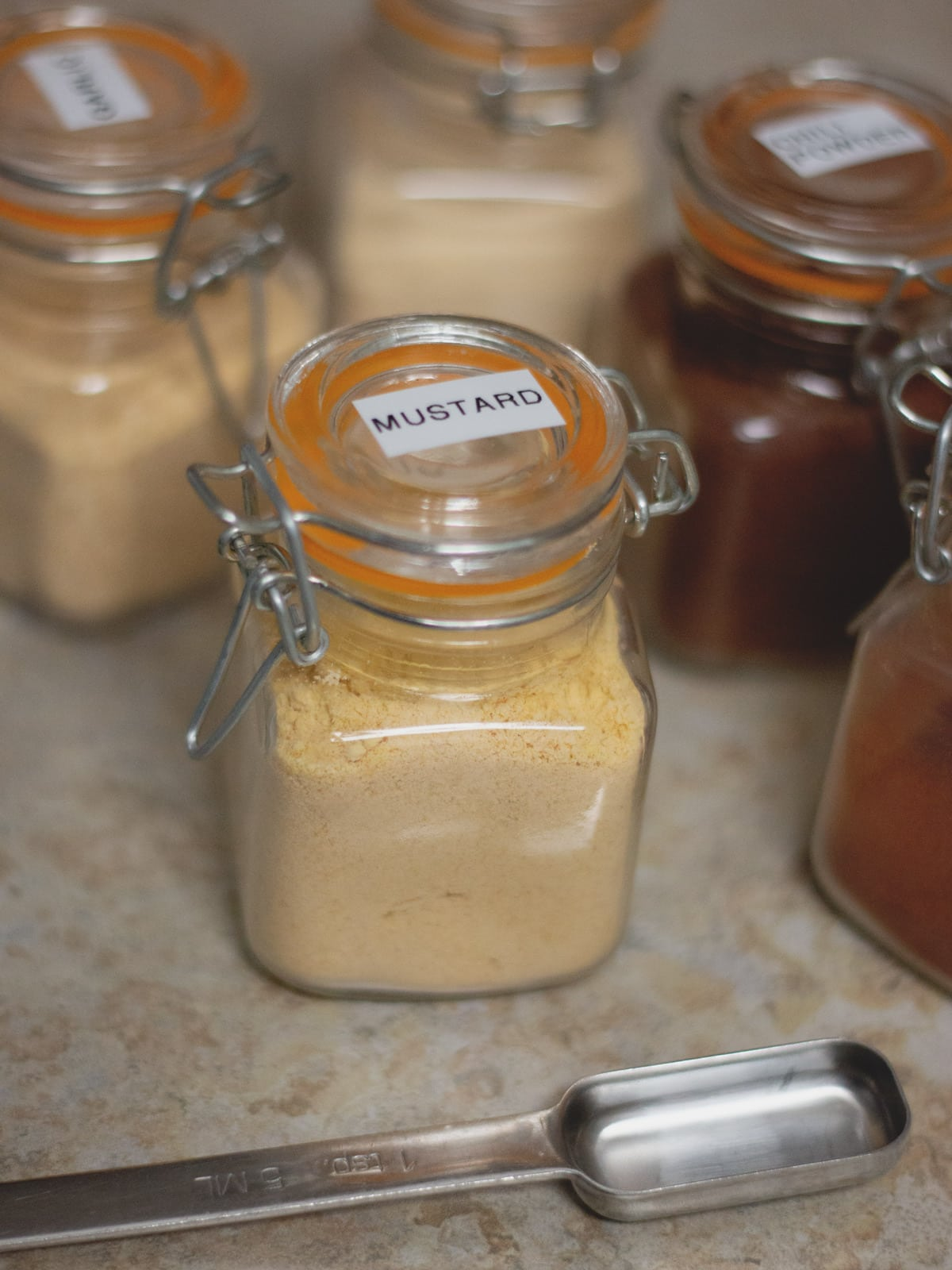 spice jars and measuring spoon