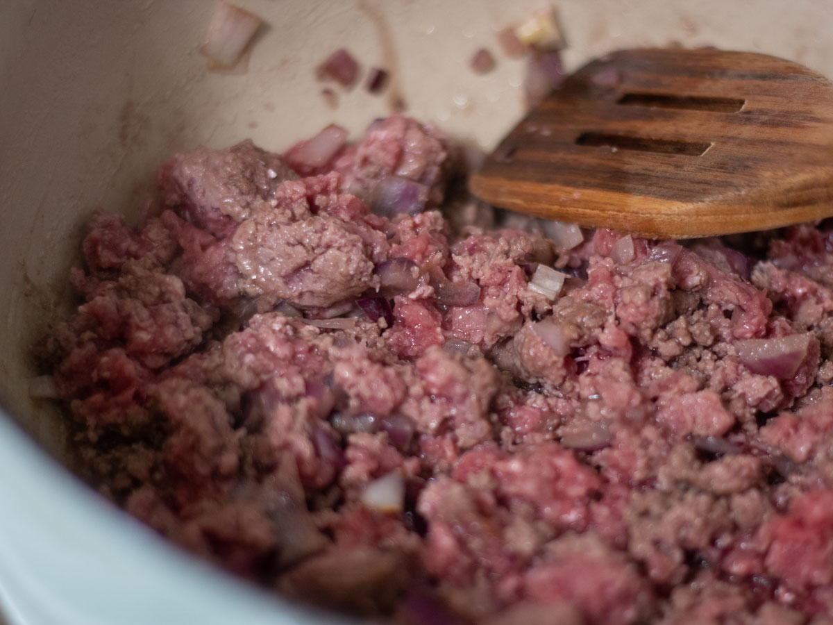 ground beef and onion cooking in soup pot