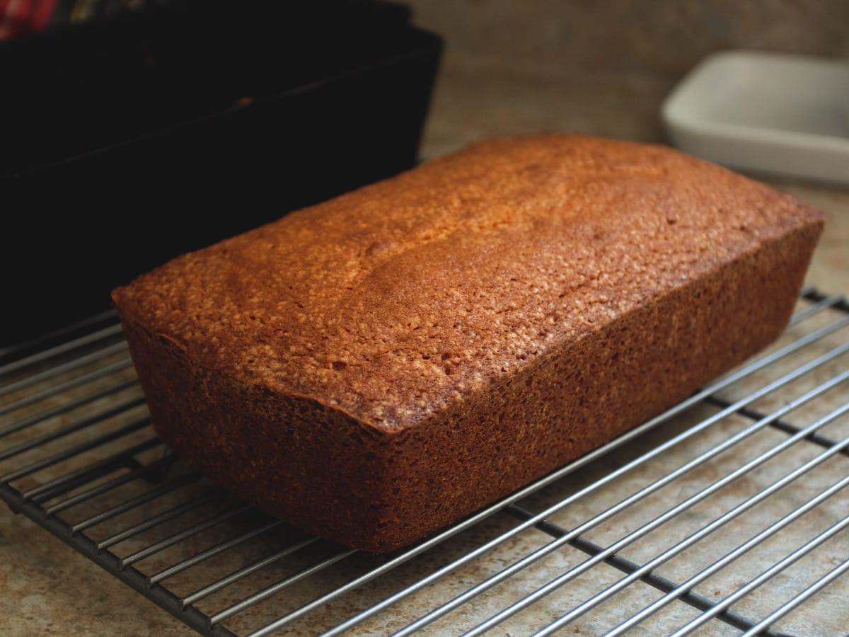 orange pound cake cooling on rack