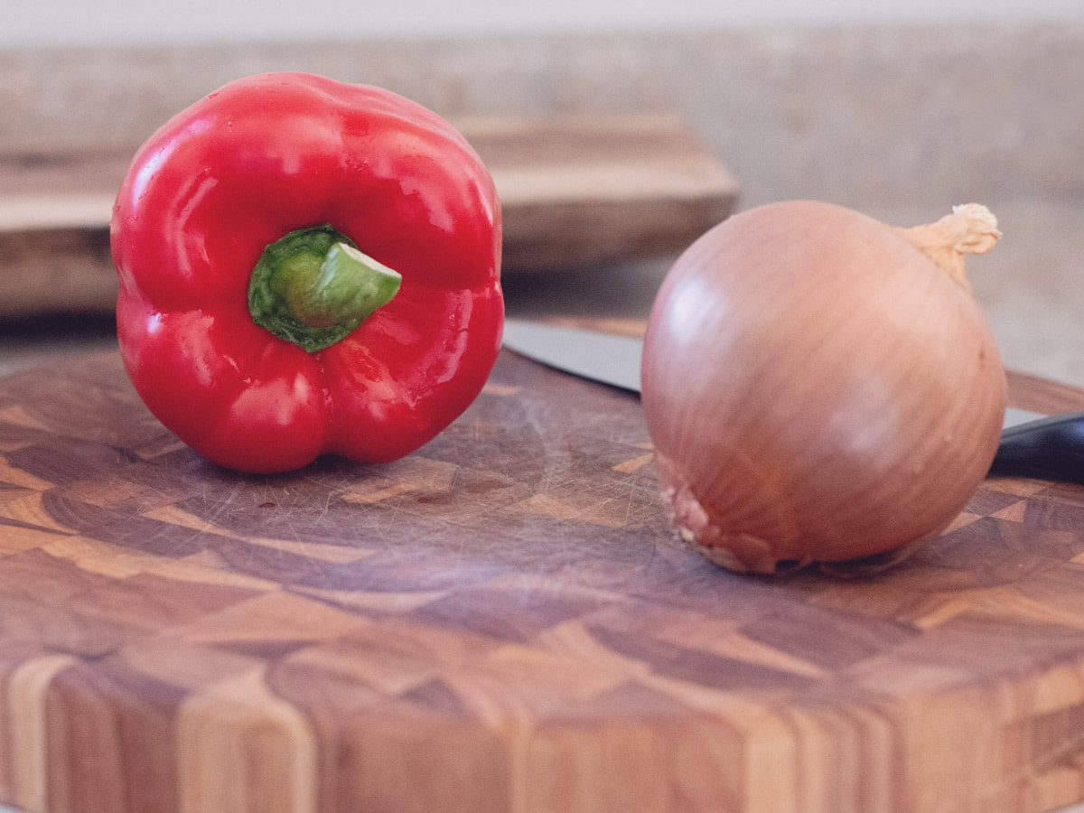 pepper and onion on a cutting board