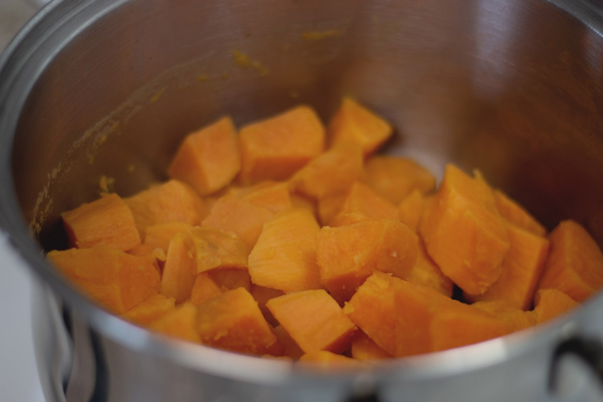cubed sweet potatoes in a sauce pan