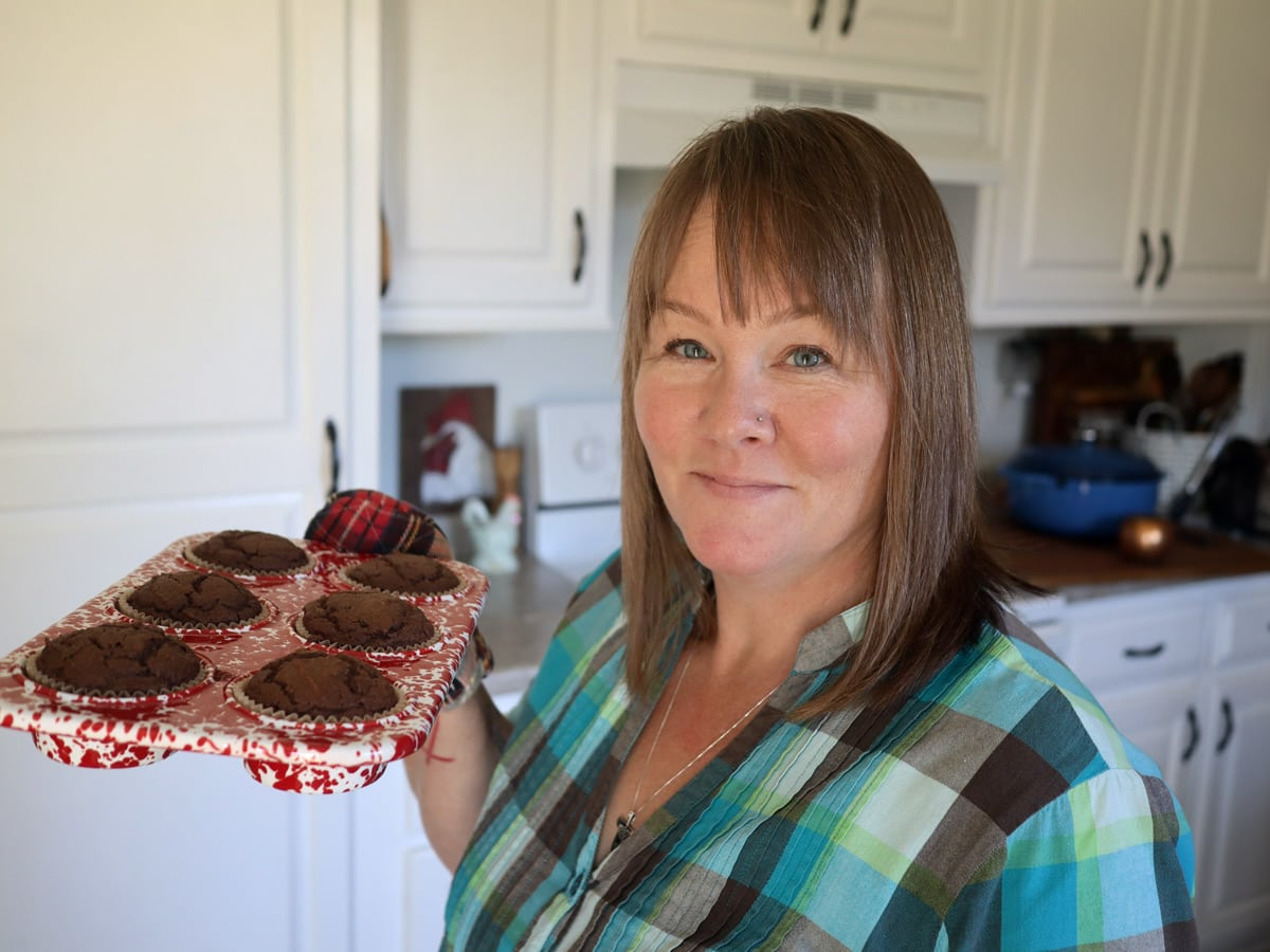 Constance holding a pan of muffins