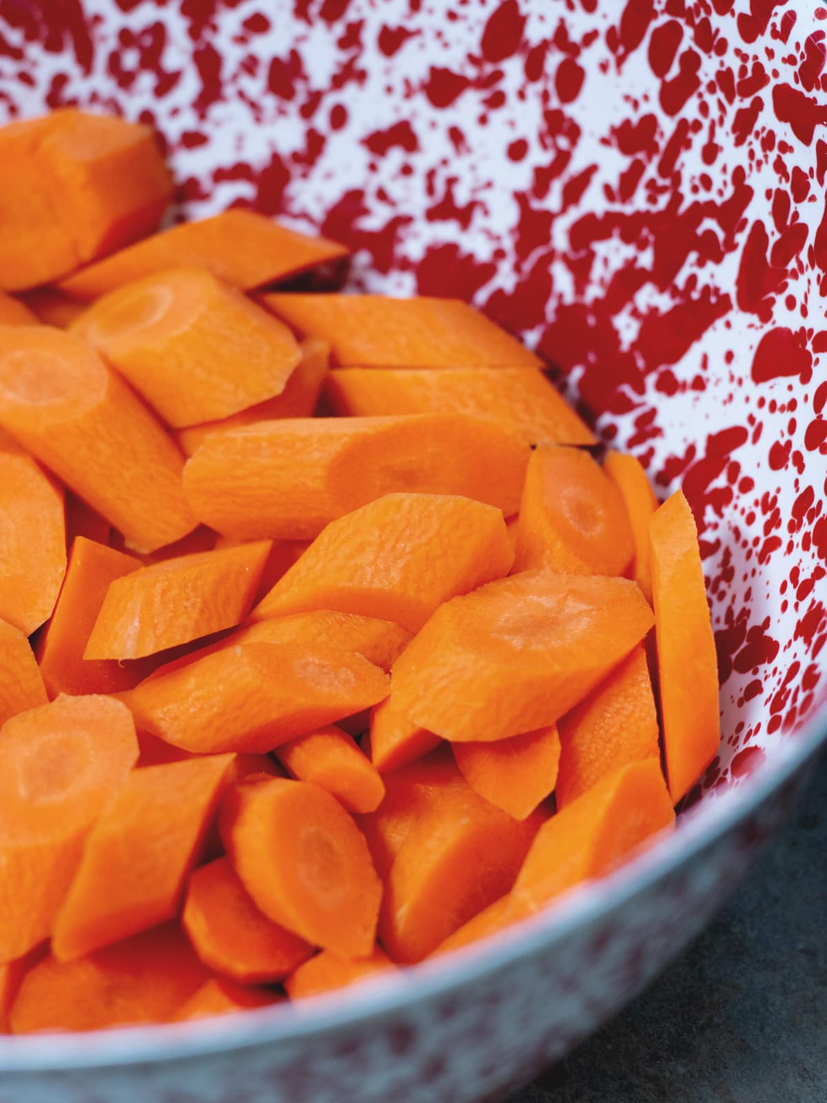 sliced carrots in a mixing bowl