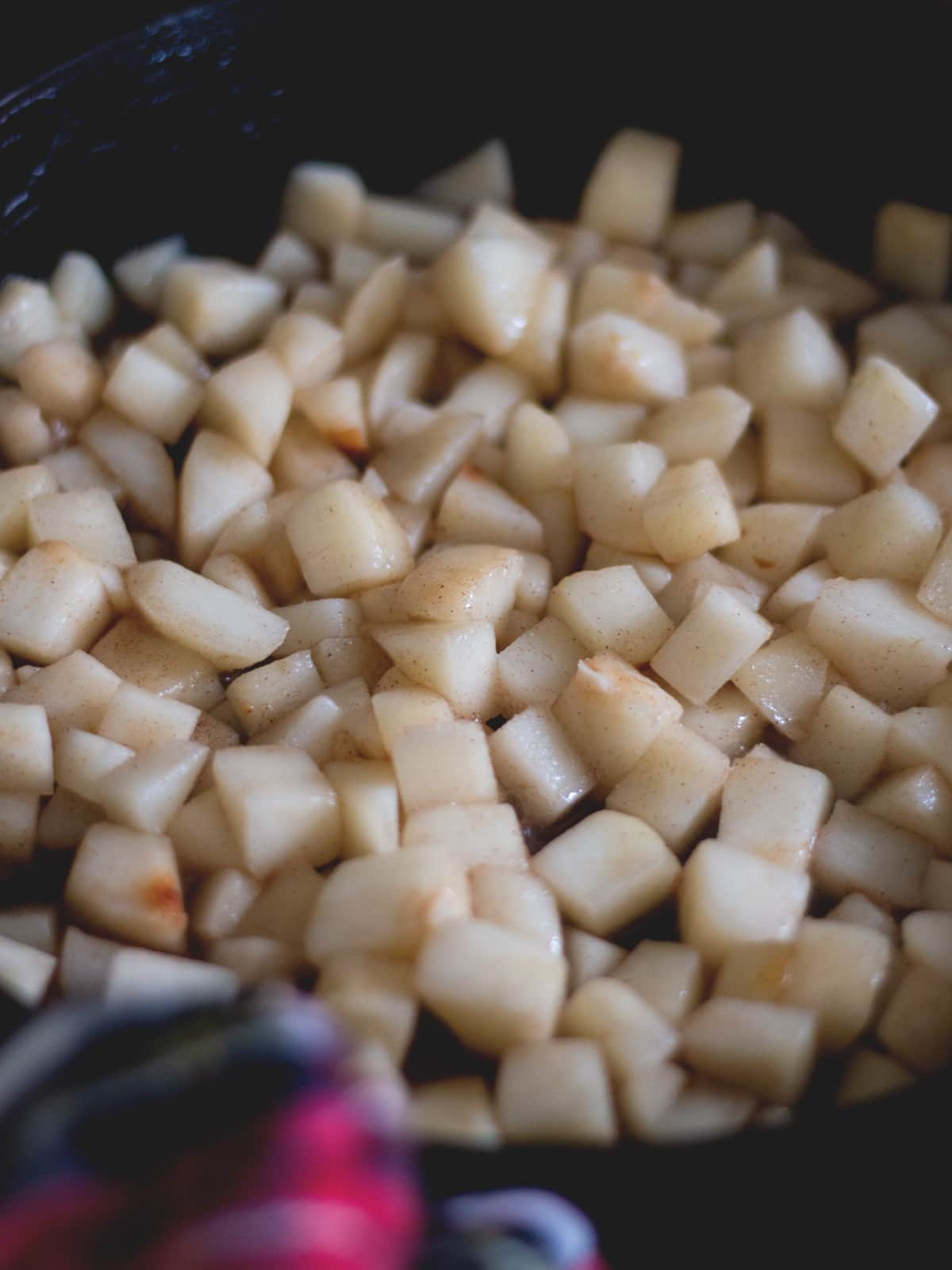 diced pears cooking in a cast iron skillet'