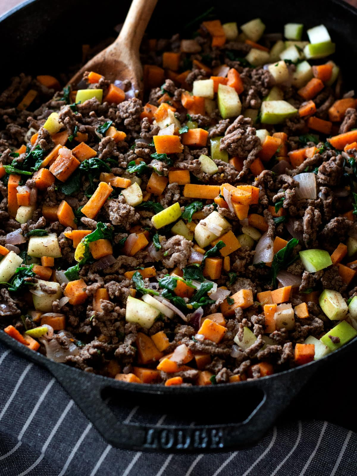 """Beef & Sweet Potato Dinner   Paleo This simple skillet dinner with sweet potato, ground beef, apple and spinach is one of my favorite """"any night"""" dishes."""