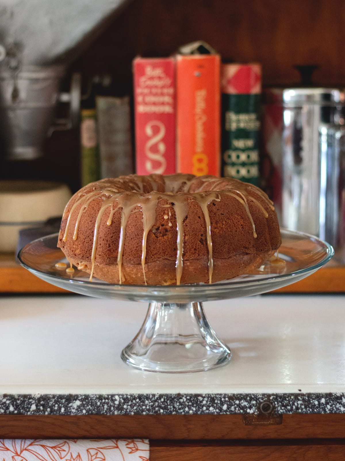 Apple Bundt Cake with Brown Sugar Glaze - Nice chunks of apple, crunchy pecans and a brown sugar glaze makes this cake the perfect autumn treat.